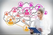 Digital composite of blonde businesswoman using tablet pc with cloud computing graphic