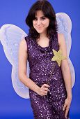 foto of tinkerbell  - young beautiful woman dressed as tinkerbell studio picture - JPG