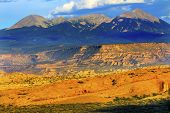 image of southwest  - La Salle Mountains Yellow Rock Canyon Arches National Park Moab Utah USA Southwest. ** Note: Visible grain at 100%, best at smaller sizes - JPG