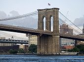 stock photo of brooklyn bridge  - A nice view of the Brooklyn Bridge and the East River in lower Manhattan - JPG