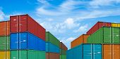 pic of export  - export or import shipping cargo containers stacks in port under sky - JPG