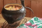 foto of dutch oven  - Traditional stew meal cooked in Russian wood-fired oven