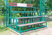 image of bleachers  - Small bleachers near the sport filed of urban park - JPG