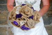 foto of ceremonial clothing  - A cloth embroidered wedding bouquet being held by a bride before her wedding. ** Note: Visible grain at 100%, best at smaller sizes - JPG
