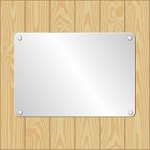 stock photo of plaque  - wooden planks bacground with metallic plaque  - JPG