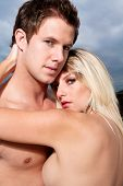stock photo of nude couple  - Goodlooking young couple topless on the beach - JPG