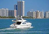 Small White Yacht and Miami Beach Condos