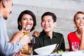 stock photo of chinese restaurant  - Asian friends - JPG
