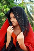 picture of rajasthani  - A beautiful and Rajasthani girl shying away from the camera - JPG