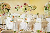 picture of vase flowers  - Nice flowers in vases on tables in restaurant on wedding day