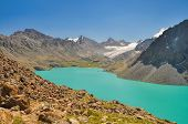 stock photo of shan  - Picturesque turquoise lake in Tien - JPG