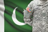 stock photo of pakistani flag  - American soldier with flag on background  - JPG