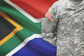 stock photo of south american flag  - American soldier with flag on background  - JPG