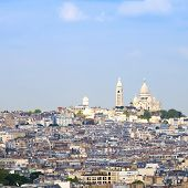 stock photo of moulin rouge  - Paris Montmartre hill district and Sacre Coeur Basilica church - JPG