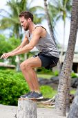 pic of work bench  - Fitness athlete bench jump squat jumping outside in nature landscape - JPG