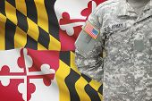 foto of maryland  - American soldier with US state flag on background  - JPG