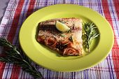 stock photo of pangasius  - Dish of Pangasius fillet with rosemary and lime on plate and fabric background - JPG