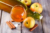 picture of cider apples  - Apple cider in wine glass and bottle - JPG