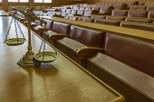 picture of justice law  - Symbol of law and justice in the empty courtroom law and justice concept focus on the scales