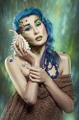 foto of conch  - Portrait of a girl with blue hair in a nautical theme with a conch - JPG