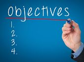 picture of objectives  - Man Hand writing Objectives to do list with marker - JPG