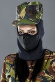 stock photo of female mask  - Female soldier in camouflage outfit and mask - JPG