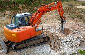 stock photo of hydraulics  - Large hydraulic Jackhammer Smashing Rocks on construction site - JPG