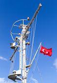 image of mast  - White ship mast with the Turkish flag over blue sky background - JPG