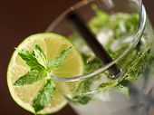 picture of mojito  - Single Mojito cocktail shot on a bar counter in a nightclub  - JPG