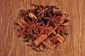 stock photo of cinnamon sticks  - Heap of star anise cinnamon sticks and cloves - JPG