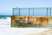 stock photo of oceanography  - A sand groin used in oceanography to block sand from eroding the beaches - JPG