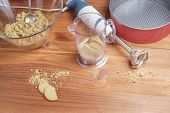 picture of cake-mixer  - beatered cookies for making cakes on wooden table - JPG