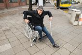 foto of disability  - Disabled Man Trying To Walk With The Help Crutches - JPG