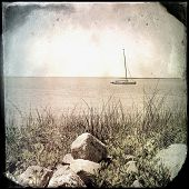 foto of outer  - Instagram vintage effect filtered image of a boat on the bay - JPG