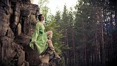 picture of elf  - Elf woman is sitting on the rocks - JPG
