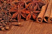 picture of cinnamon sticks  - Star anise cinnamon sticks and cloves on a wooden background - JPG