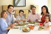 foto of extend  - Extended Hispanic Family Enjoying Meal At Home - JPG