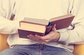 pic of bookworm  - Young man reading book - JPG