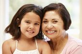 picture of granddaughter  - Hispanic grandmother and granddaughter - JPG