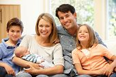 foto of new years baby  - Family at home with new baby - JPG