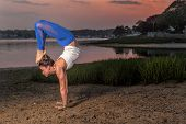 picture of scorpion  - Yoga  Model Doing eadstand Scorpion Variation On Beach - JPG