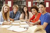stock photo of 16 year old  - Group of students working together in library - JPG