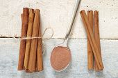 pic of cinnamon  - Some cinnamon sticks tied with a natural rope - JPG
