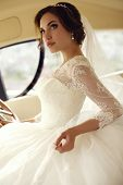picture of lace  - fashion photo of beautiful sensual bride with dark hair in luxurious lace wedding dress posing on yacht - JPG