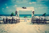 foto of caribbean  - Wedding altar on the beach in Mexico with caribbean sea in the background - JPG