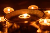 foto of altar  - Candles burning at altar in darkness closeup - JPG