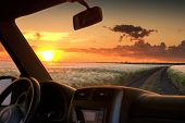 pic of riding-crop  - view from car window on field at sunset - JPG