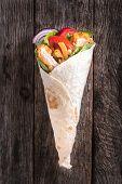 pic of sandwich wrap  - Chicken wrap sandwich on the wooden background - JPG