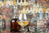 picture of cigar  - Glass of cognac with cigar on glass table - JPG