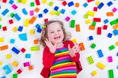 foto of girl toy  - Child playing with colorful toys - JPG